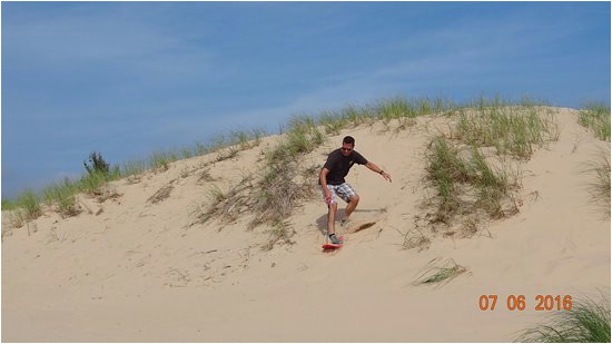surfing the dunes picture of silver lake sand dunes hart