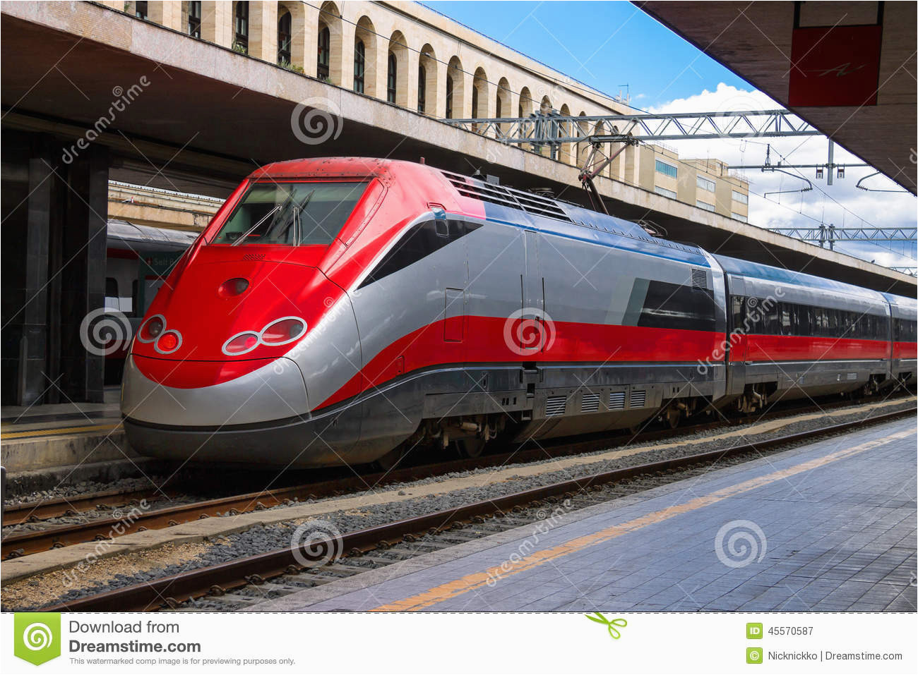 the train stops near the platform station in italy stock image