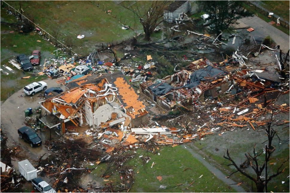 this aerial shot shows the damage and destruction to homes in the